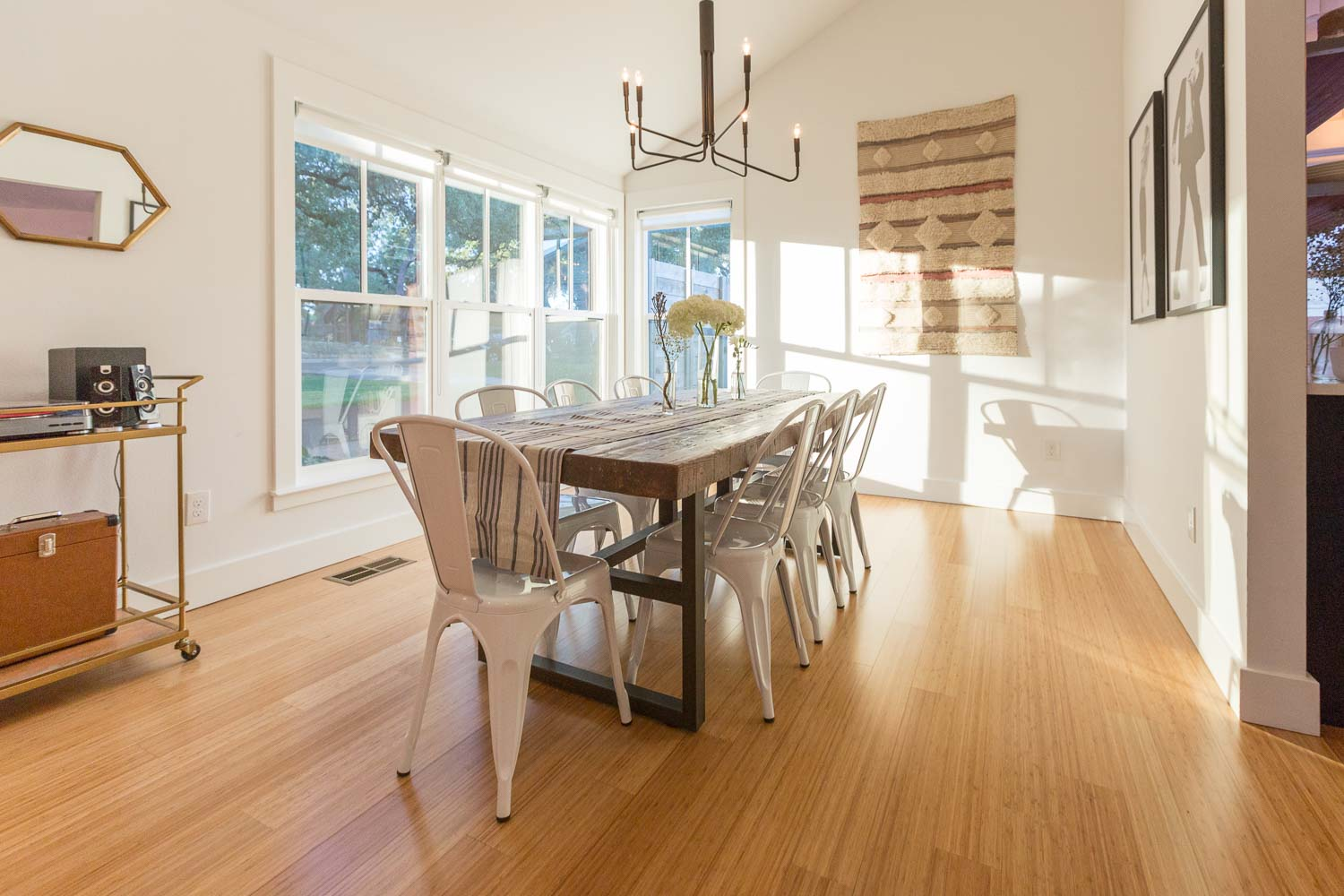 We love the homeowner's decor and light fixture combined with our thoughtful window placement, ceiling vaults, and floorplan designs in this modern dining room.