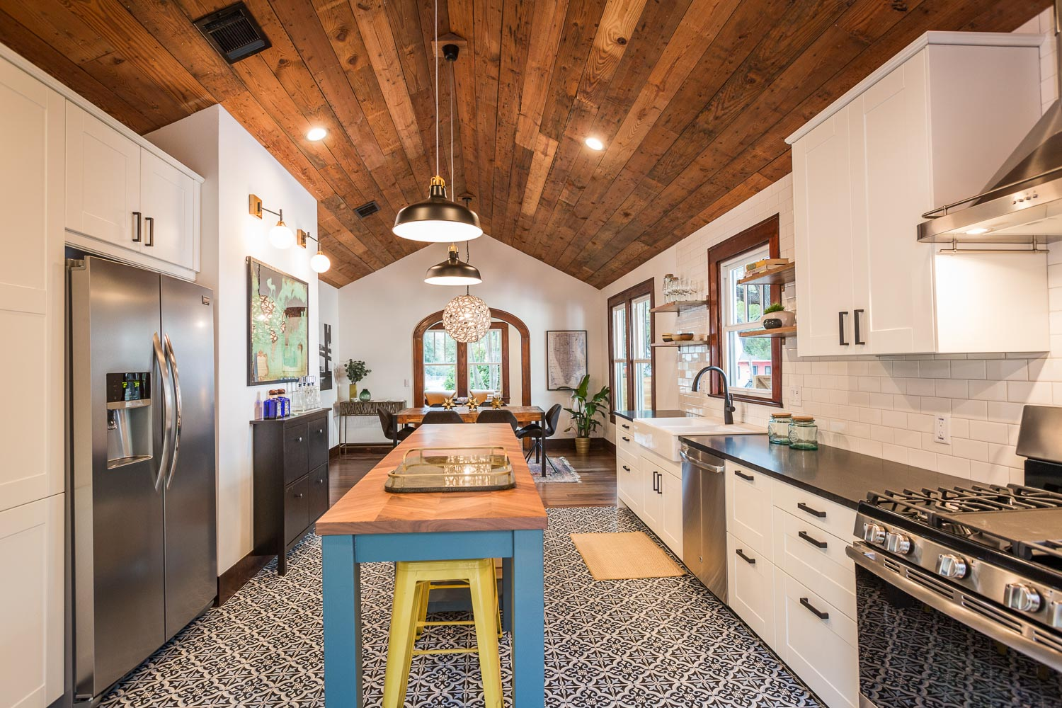 Another view of the kitchen towards the open dining room. Notice the vault and shiplap continues.