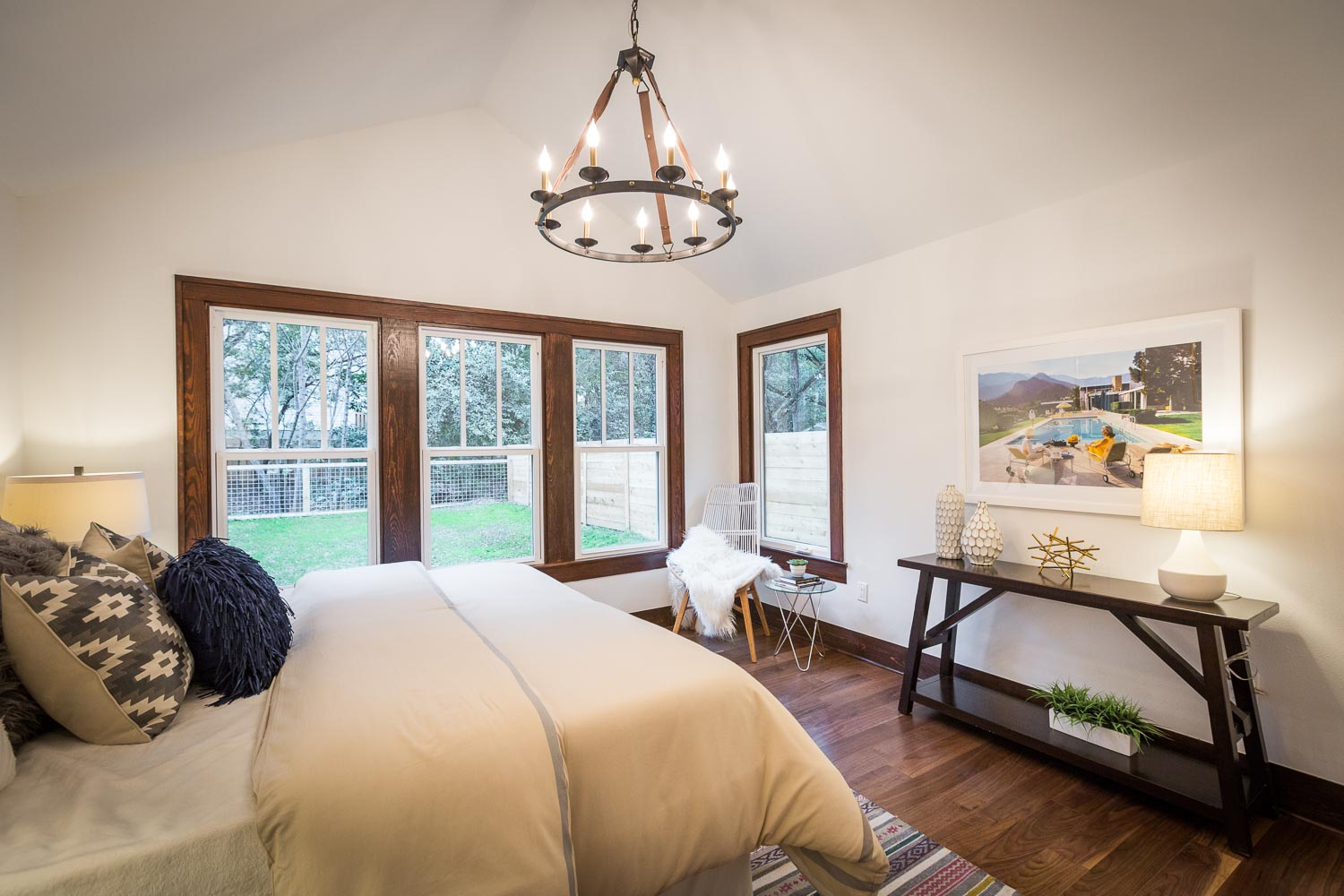 Another view of the master bedroom. Elite Austin Staging provided the perfect staging for the exceptional room. Notice the window bank with dark wood trim.