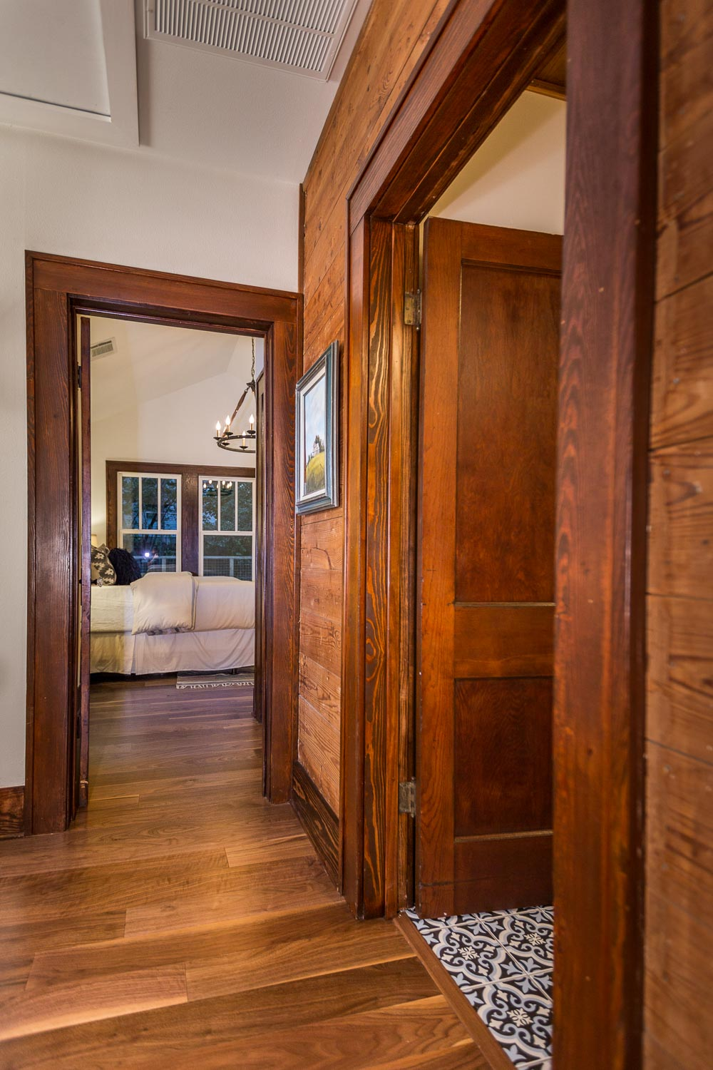The hallway is one of the most interesting areas of the Austin bungalow. The original shiplap and trim is showcased. My favorite flea market painting hangs in the hallway and brings all the colors together.