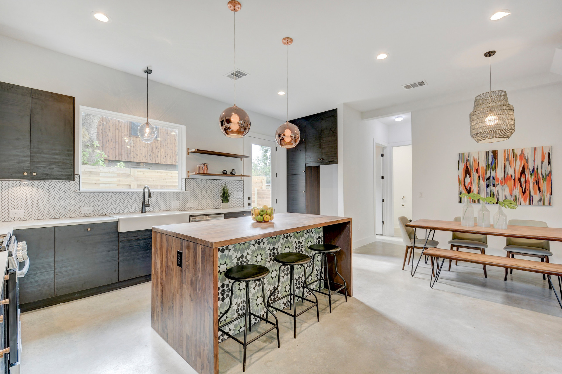 Modern Kitchen with Ikea cabinets, walnut butcher block with a waterfall edge, Rustico Casablanca Cement Tile, island, matte black faucet, and copper accents!