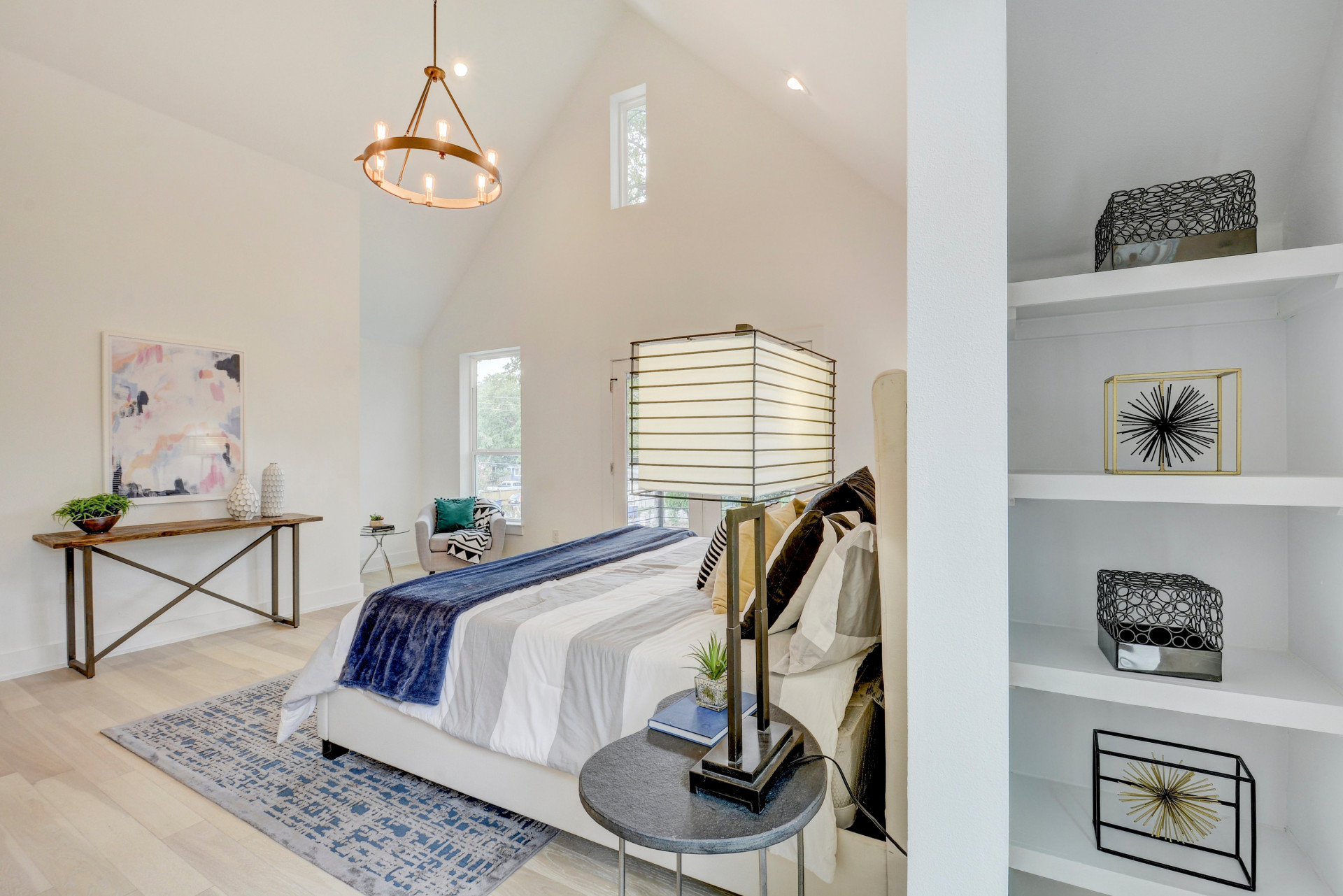 Dream Master Bedroom with vaulted ceilings, balcony, built-ins and white oak floors.