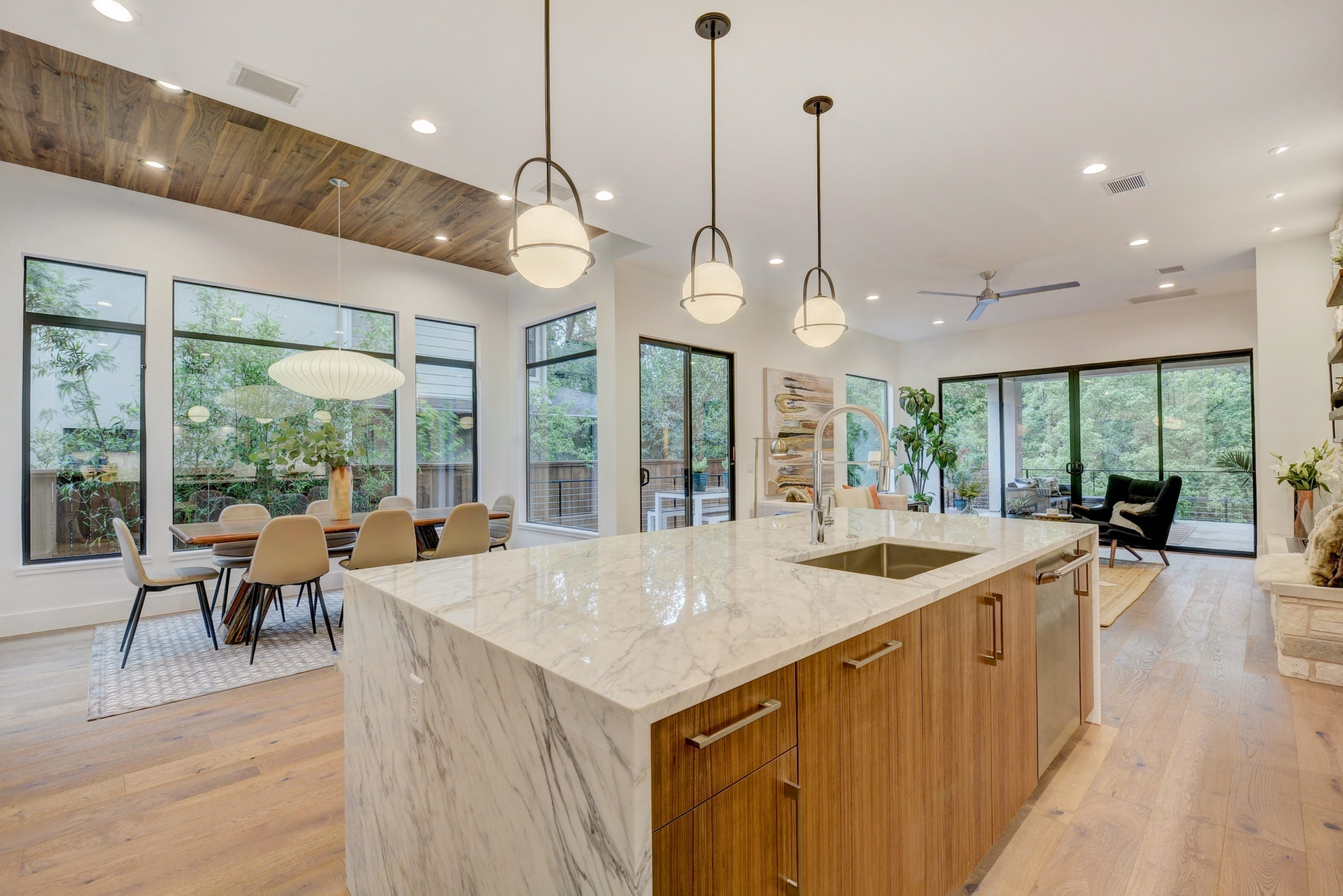 Premium custom kitchen looking into great room and dining room in Bouldin new home Austin Texas 78704