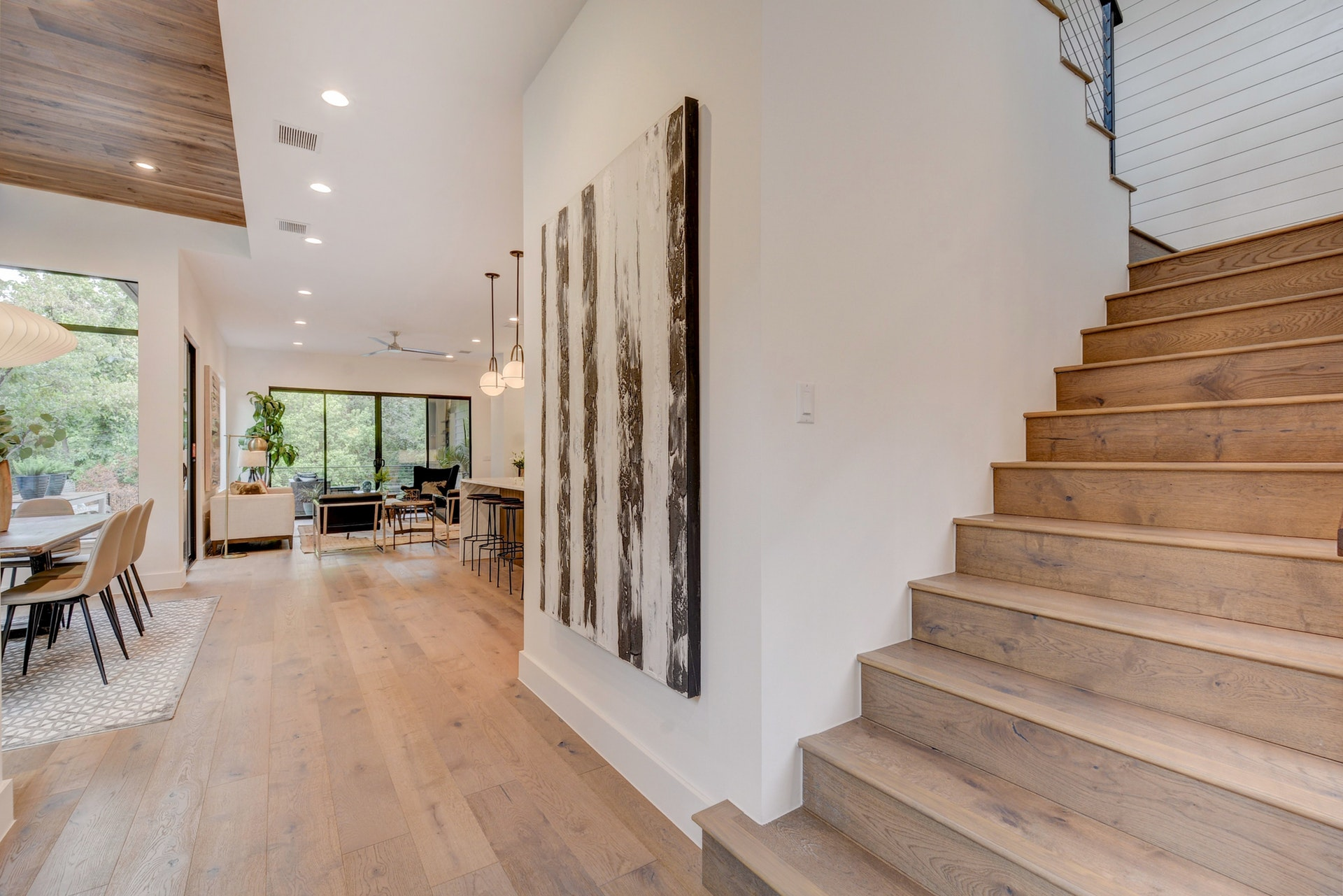 Another view of the impressive foyer and modern stairwell with shiplap at the landing.