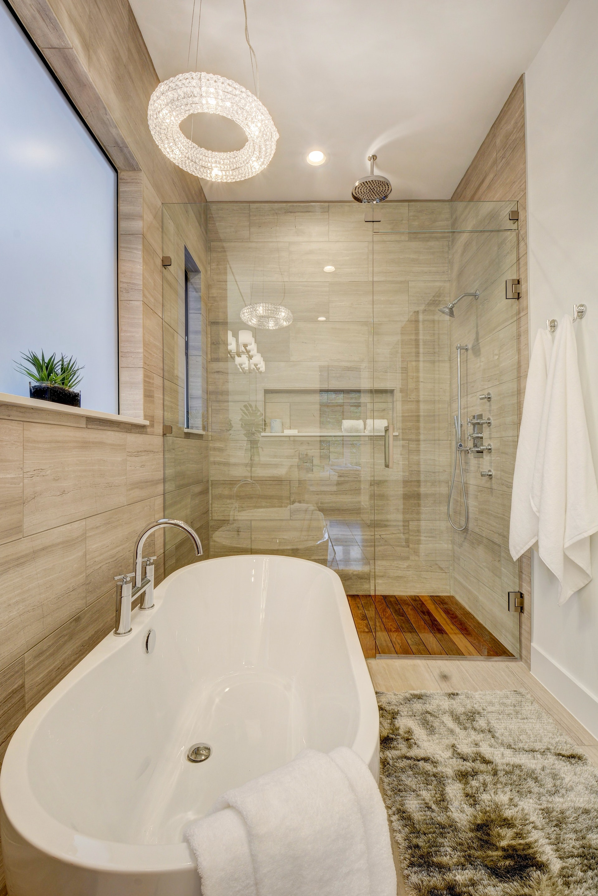 Another view of the teak shower and freestanding tub from Signature Hardware.