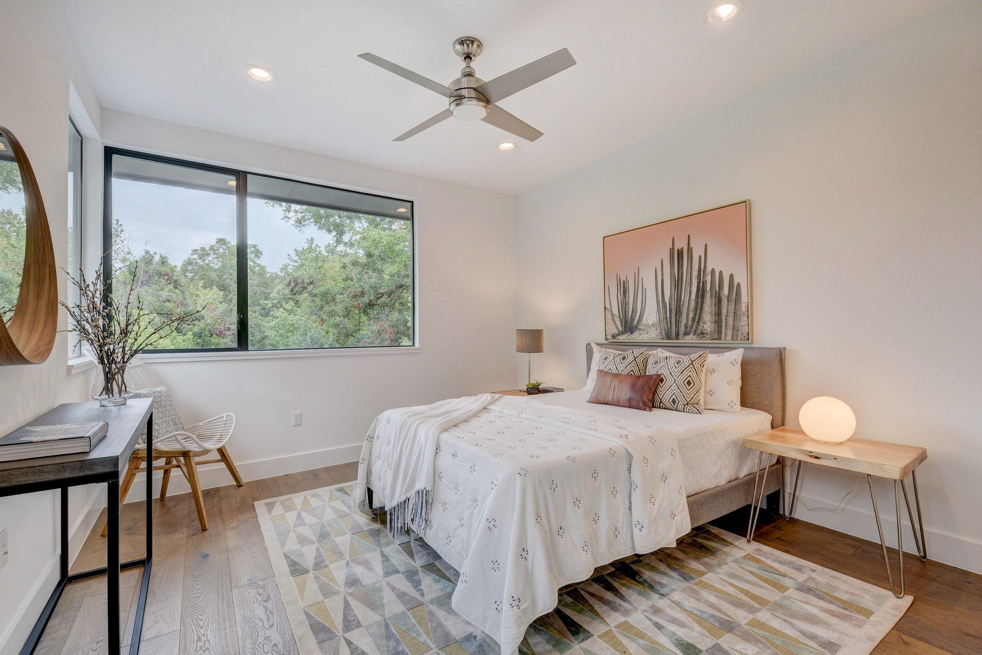 The second master suite is upstairs and includes an ensuite bathroom. The style is Marfa Texas inspired Minimalism. The art over the bed is from World Market.