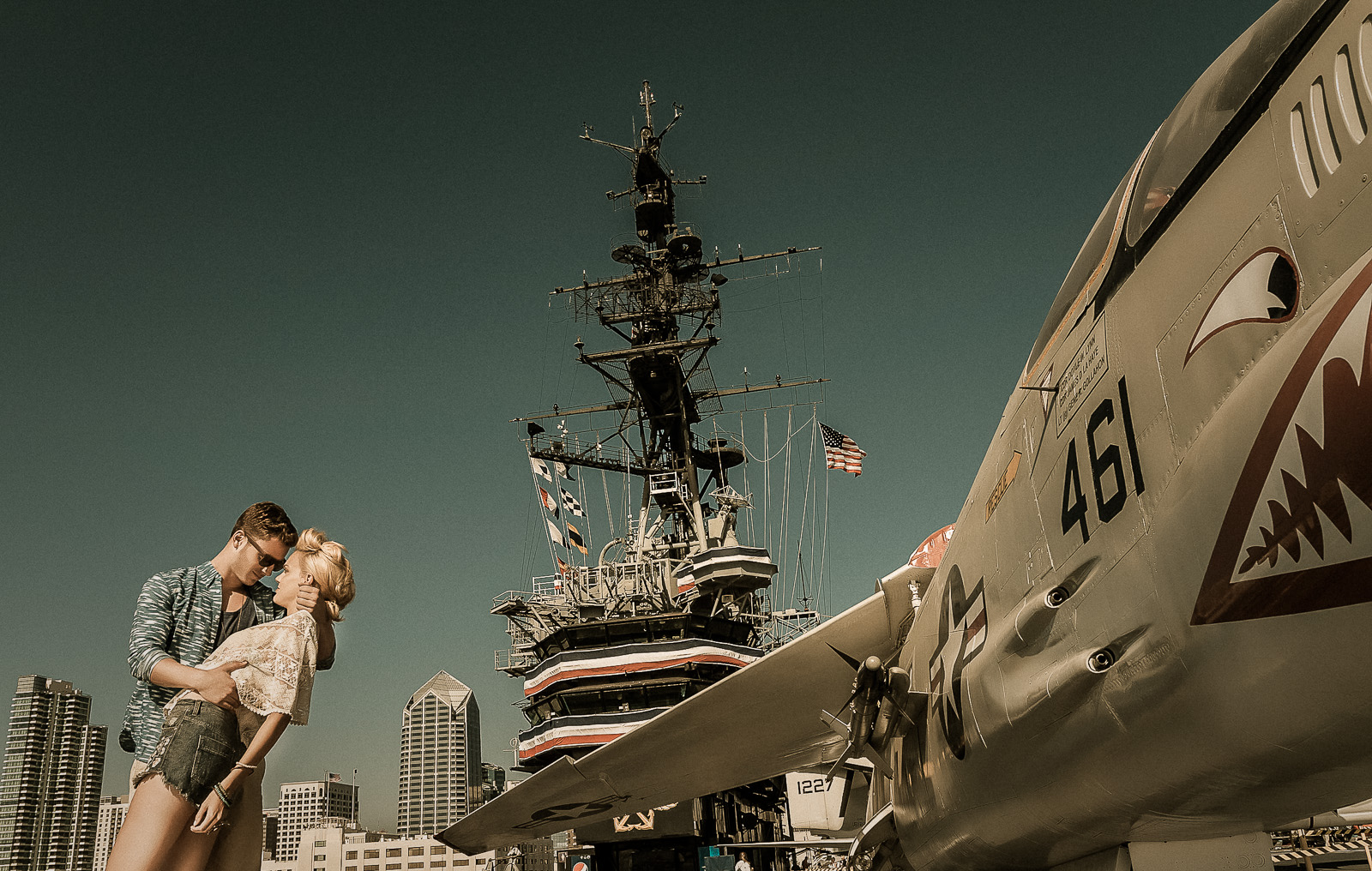 Locations matter. I am not such a fan of open endless fields because they are so repetitive in every fashion photographers' portfolio. I like to be different. This was one of the most epic locations I have shot in 2013. Its the USS Midway Museum in downtown San Diego.