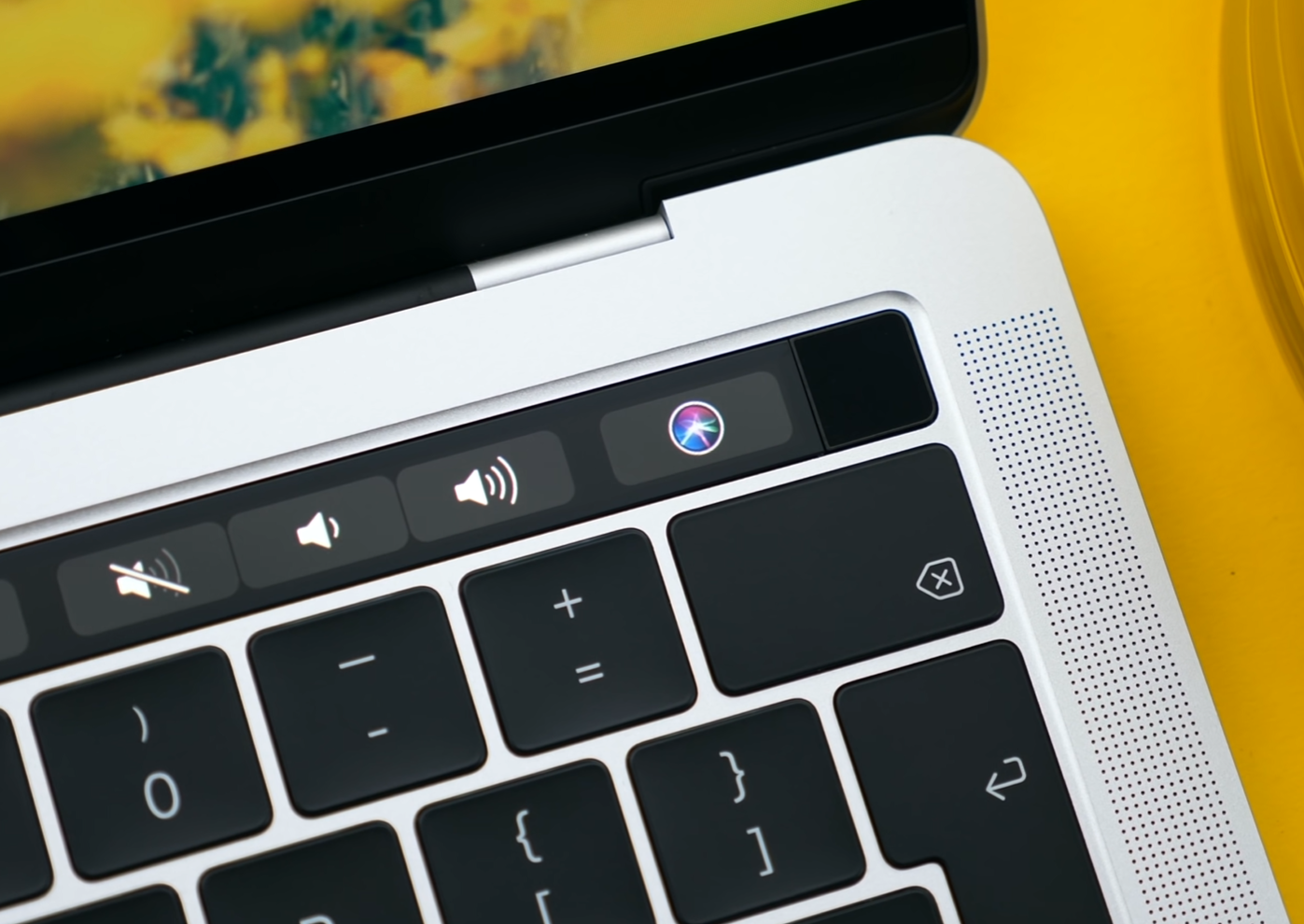 "The 13"" Baseline model now features a touch bar, as well as TouchID"