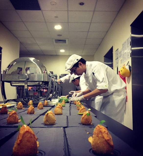 The team plating coxinhas with chipotle aioli
