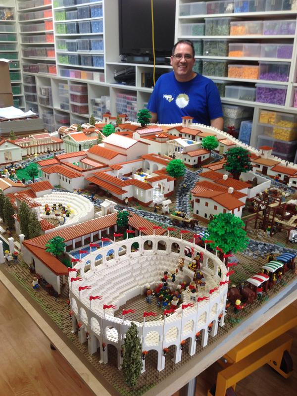 LEGO   Professional Builder Ryan McNaught with LEGO Pompeii.  Image courtesy of the Nicholson Museum.