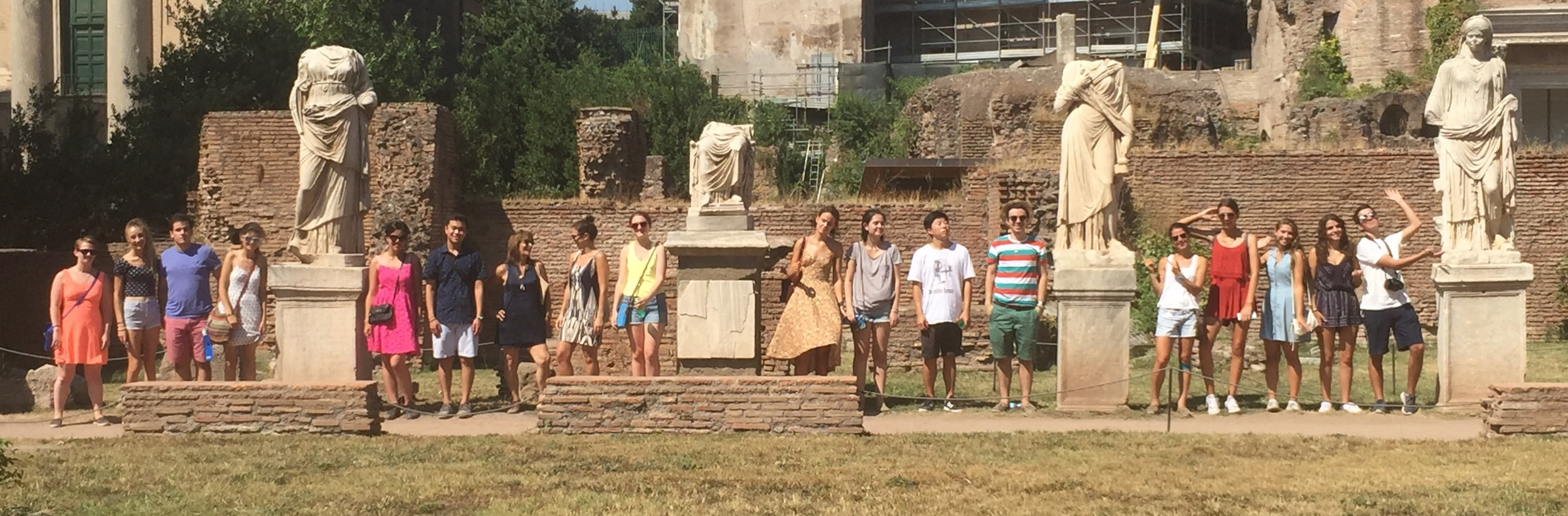 Both trips posing with the Vestal Virgins