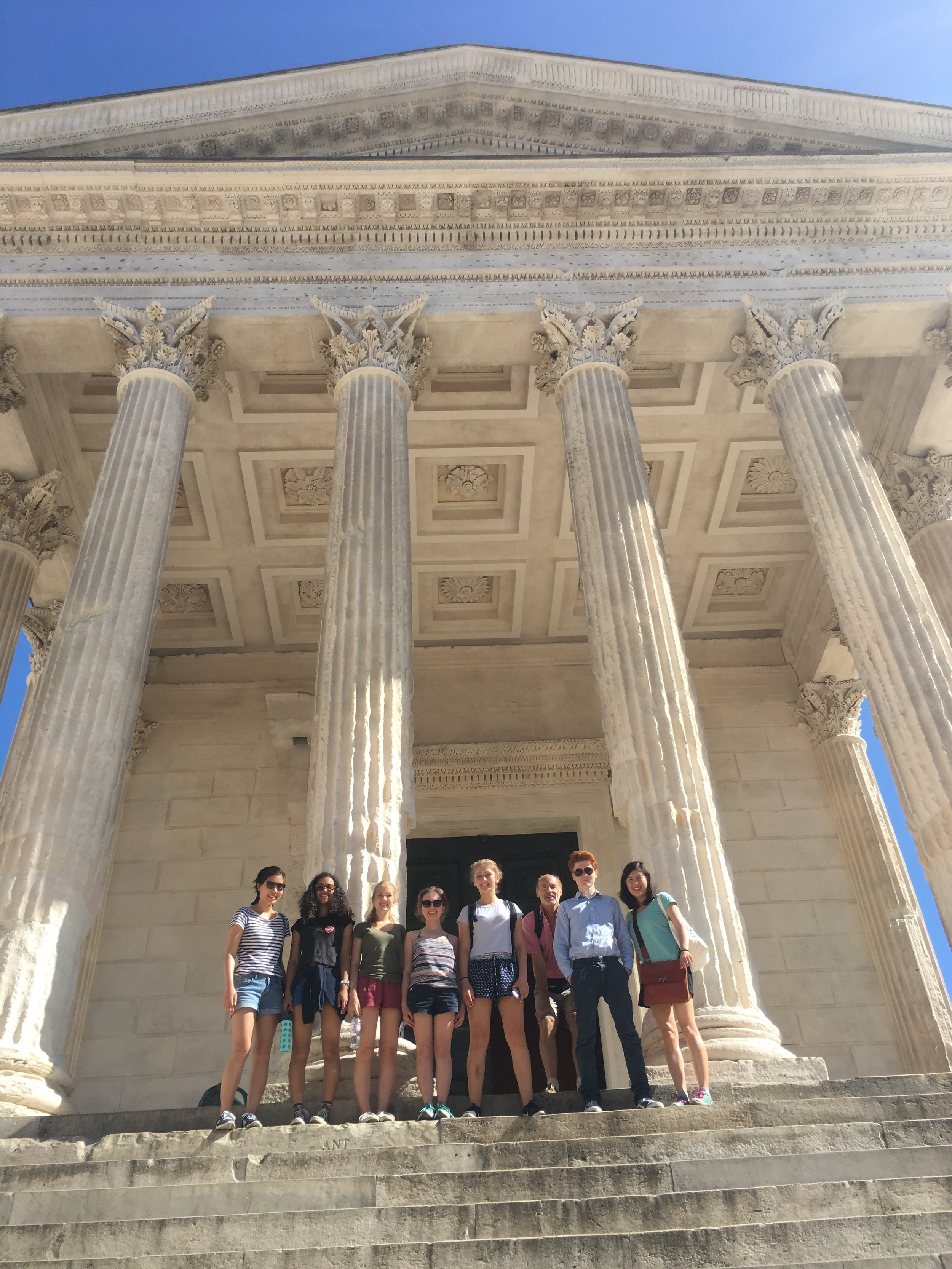 All together in front of the Maison Carrée temple in Nîmes after a long scavenger hunt.
