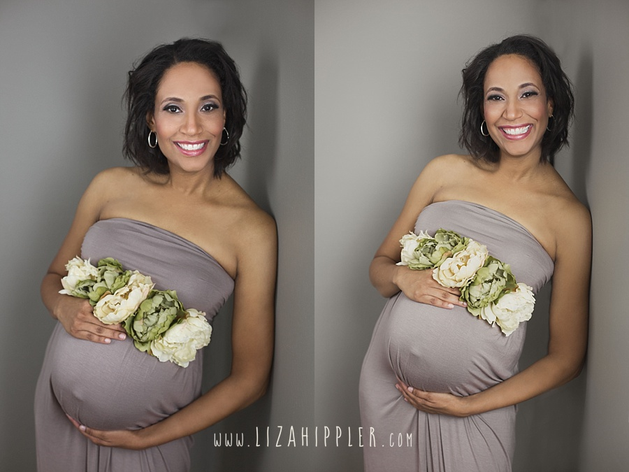 african american maternity photo with dusty purple dress and flowers