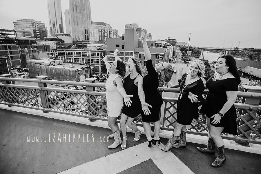 five ladies having fun on pedestrian bridge nashville tn