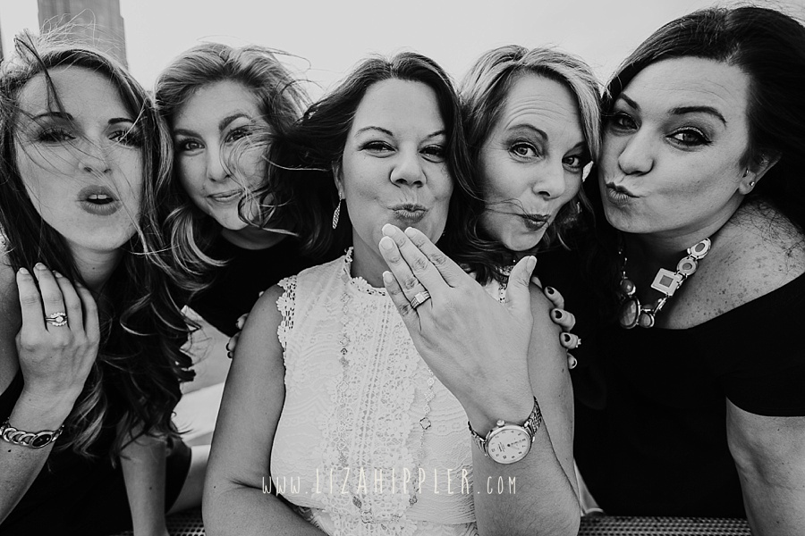 black and white closeup of five women celebrating upcoming marriage
