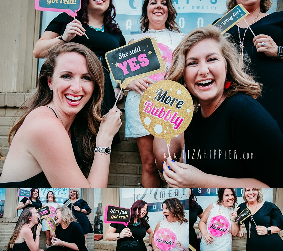 bachelorette and her friends holding fun pink, black and gold signs