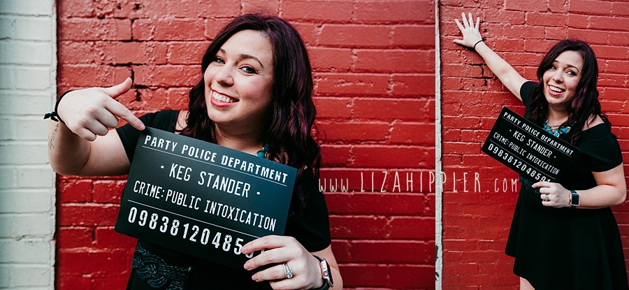 "bachelorette party girl holding ""keg stander"" crime sign against red brick wall Nashville TN"