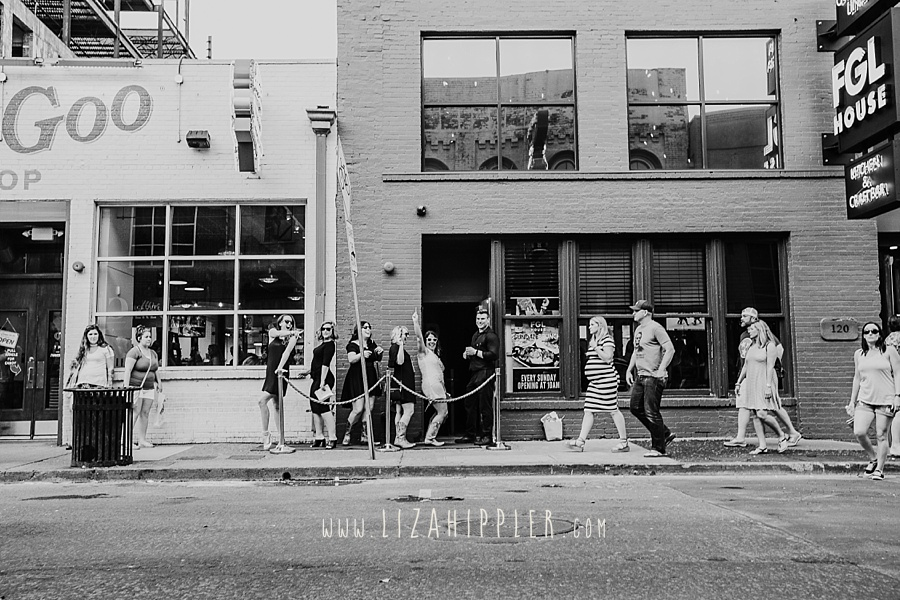 black and white photo of bachelorette party waiting in line outside of Florida Georgia Line House in downtown Nashville TN