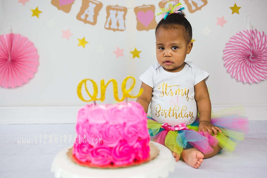 african american one year old girl in pink cake smash photo session