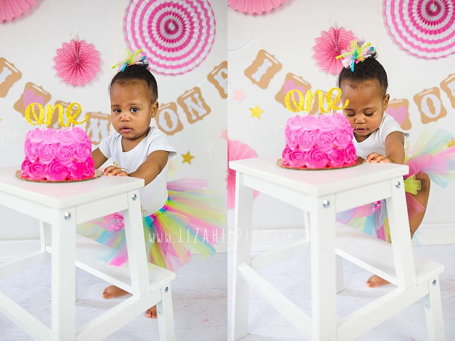 one year old girl pink and gold cake smash with white stool