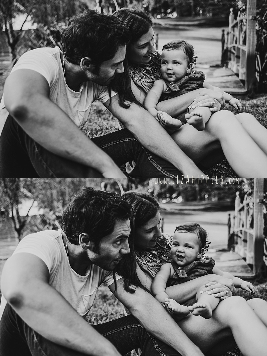 black and white image of family with baby son