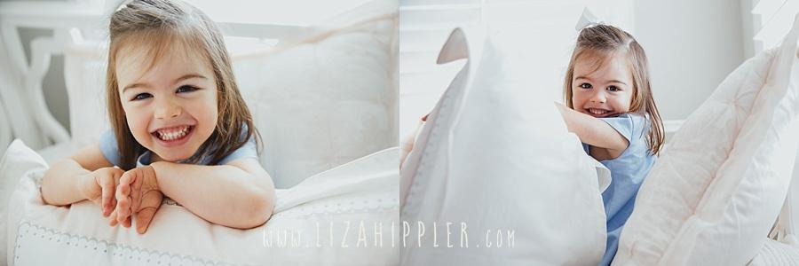 toddler girl playing in pillows