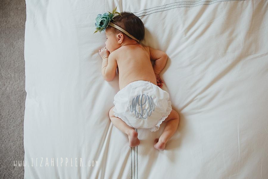 newborn girl in monogrammed diaper cover
