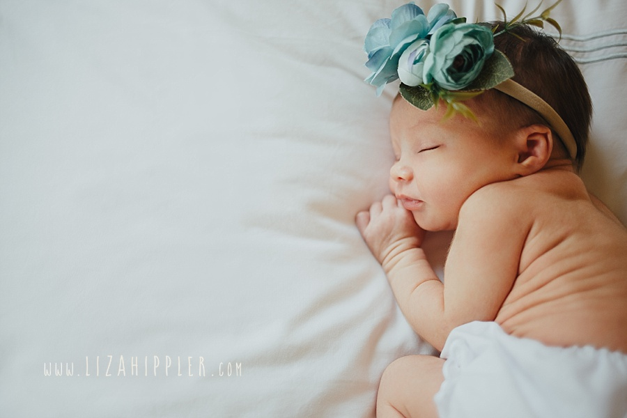 newborn girl with headband and diaper cover