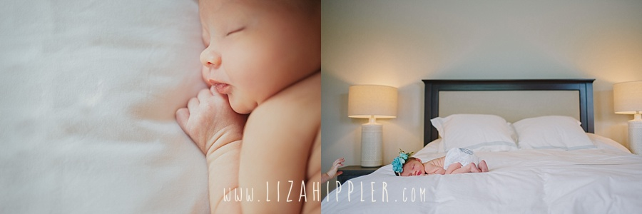 bed with white comforter and newborn girl sleeping
