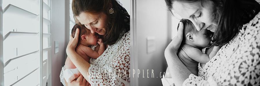 newborn girl snuggles in mama's arms