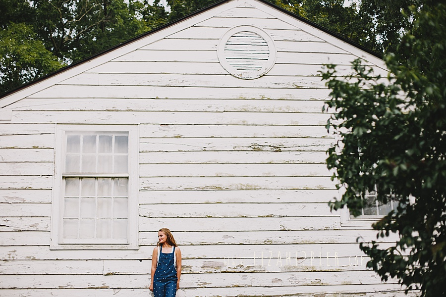beautiful old white barn used for senior shoot