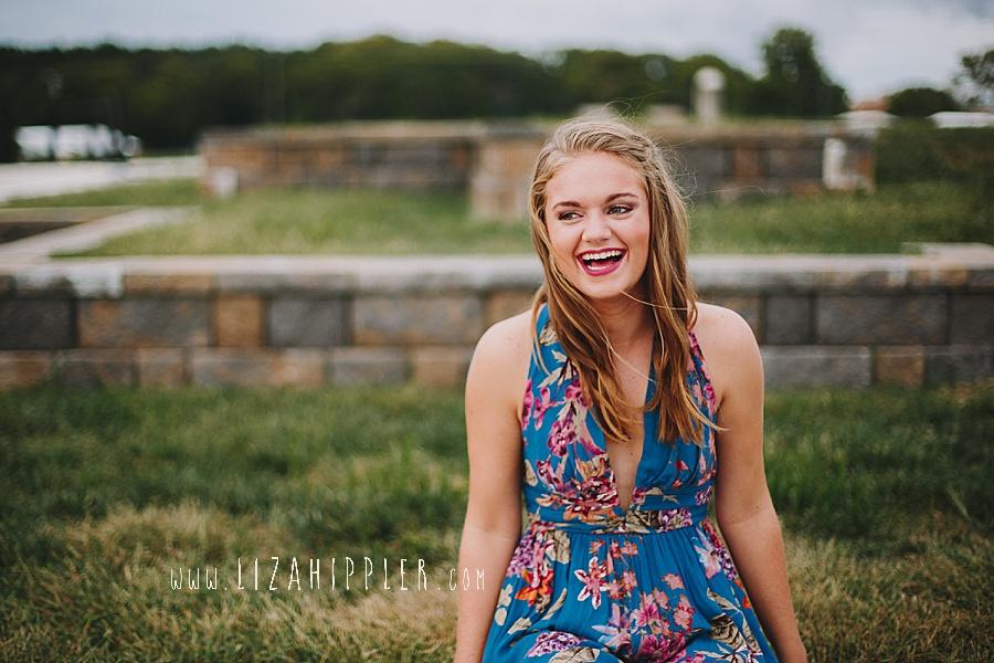 high school senior girl laughs for photos