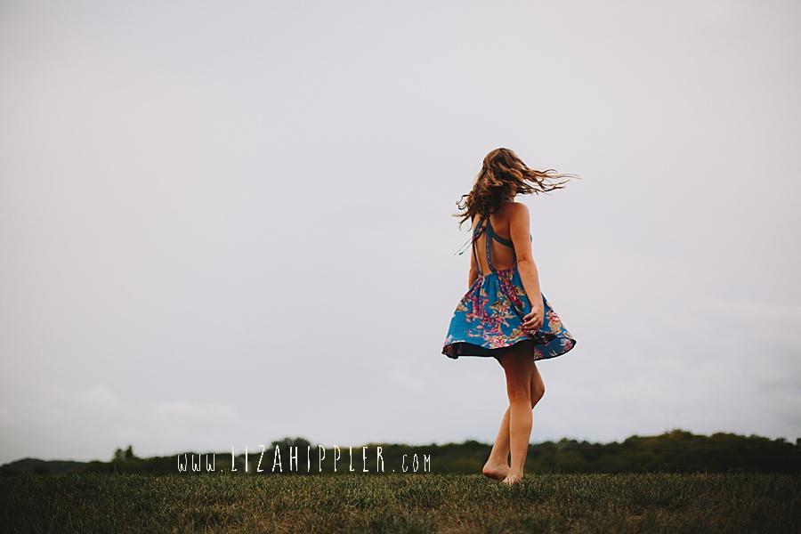 teenage girl twirls