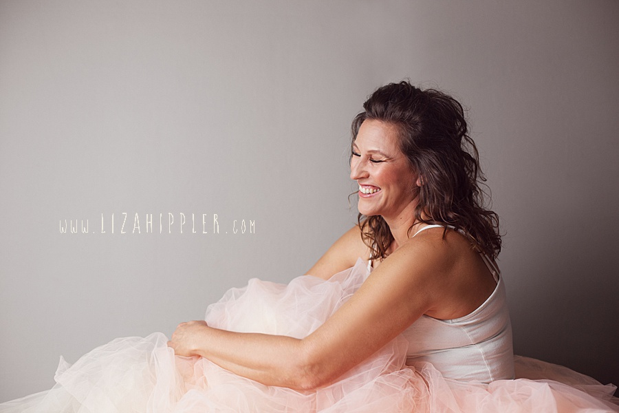 woman wearing pink tulle skirt laughs
