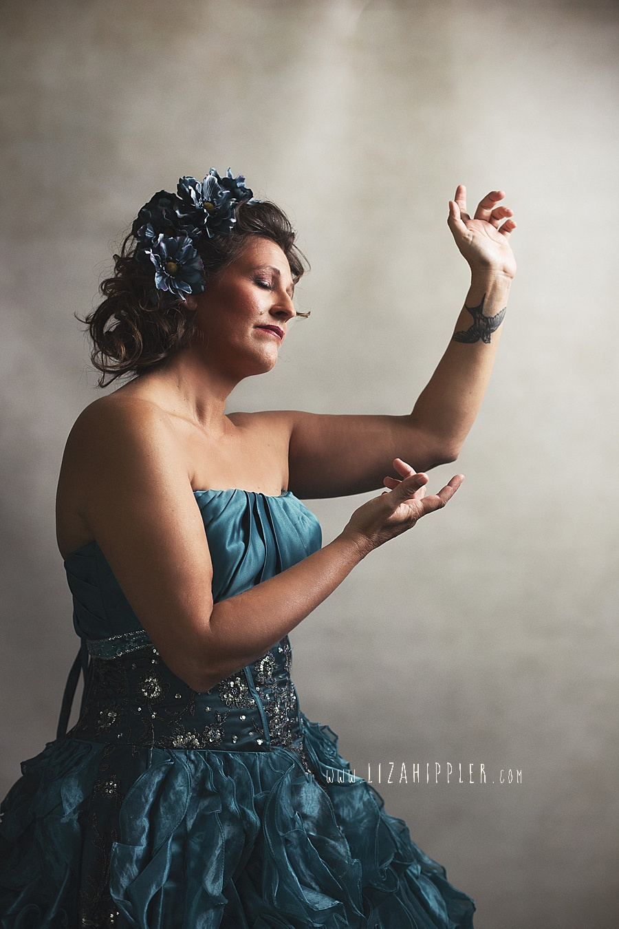 woman dancing and showing her wrist tattoo