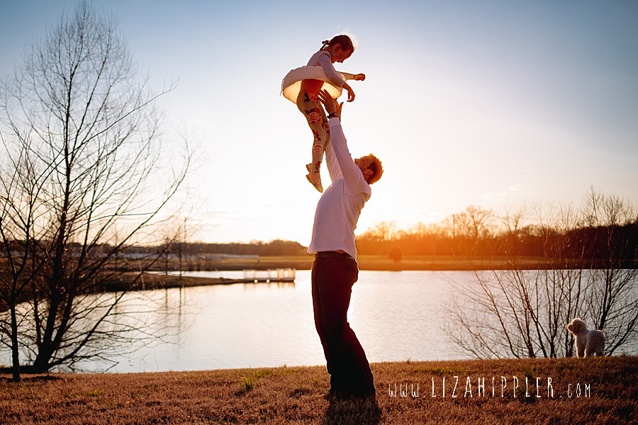 daddy tosses daughter up into the air