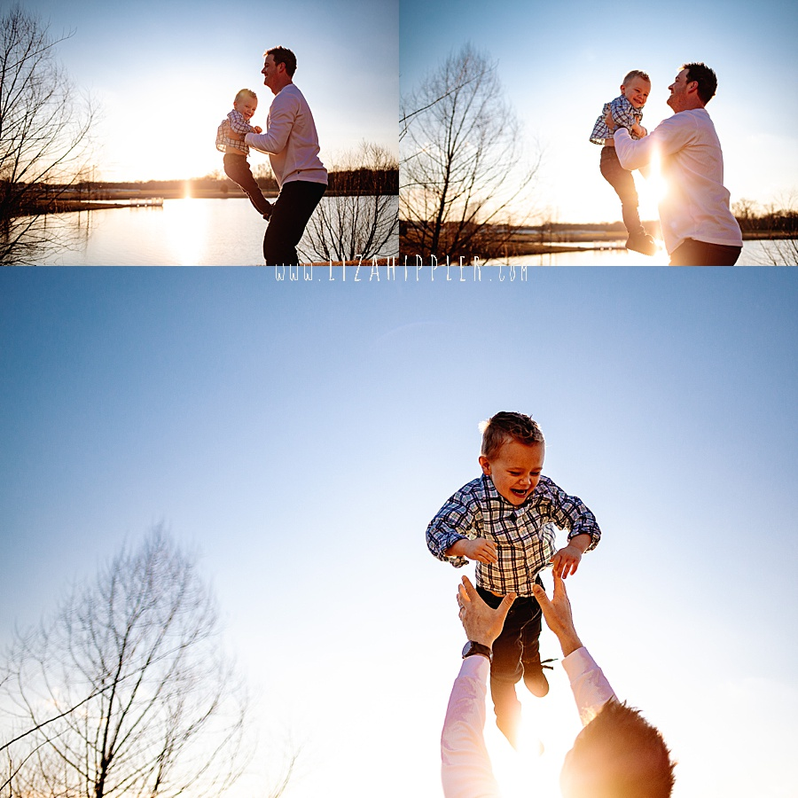 dad tosses toddler son into the air with the sunset in the back
