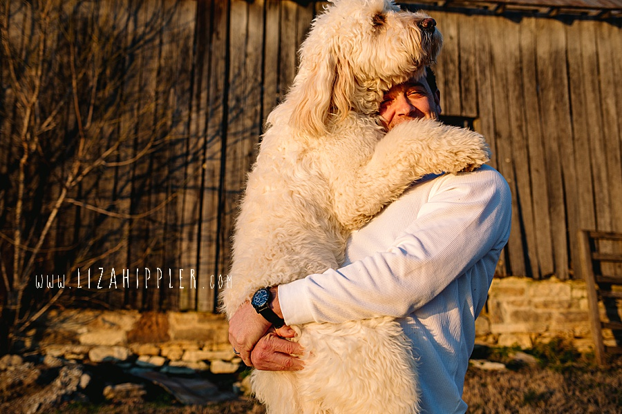 man gets big hug from giant dog