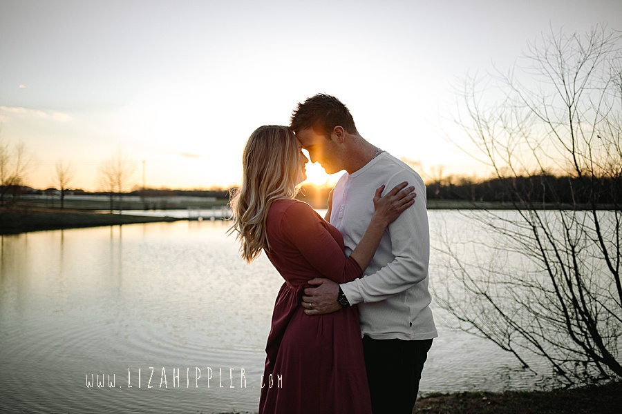 beautiful photo of blonde wife and her husband snuggling at sunset