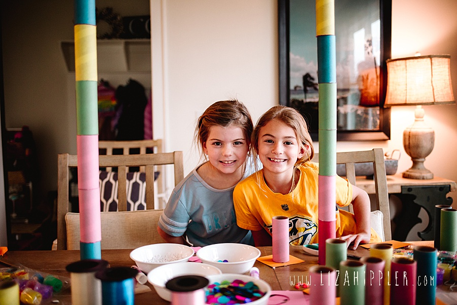 two third grade girls crafting with colorful tubes