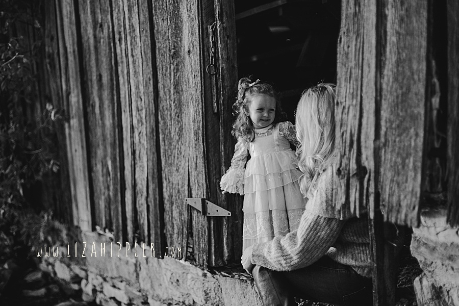 mom and baby girl talk in black and white image