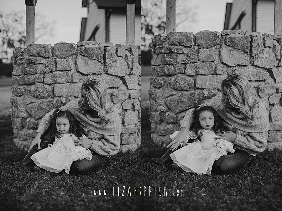 black and white images of mother and daughter sitting by a well