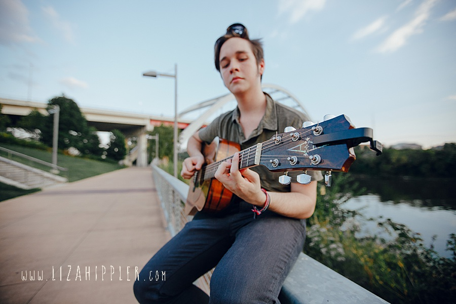 high school senior boy with guitar