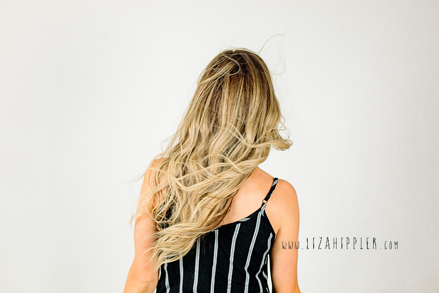 back of head long blonde hair wavy