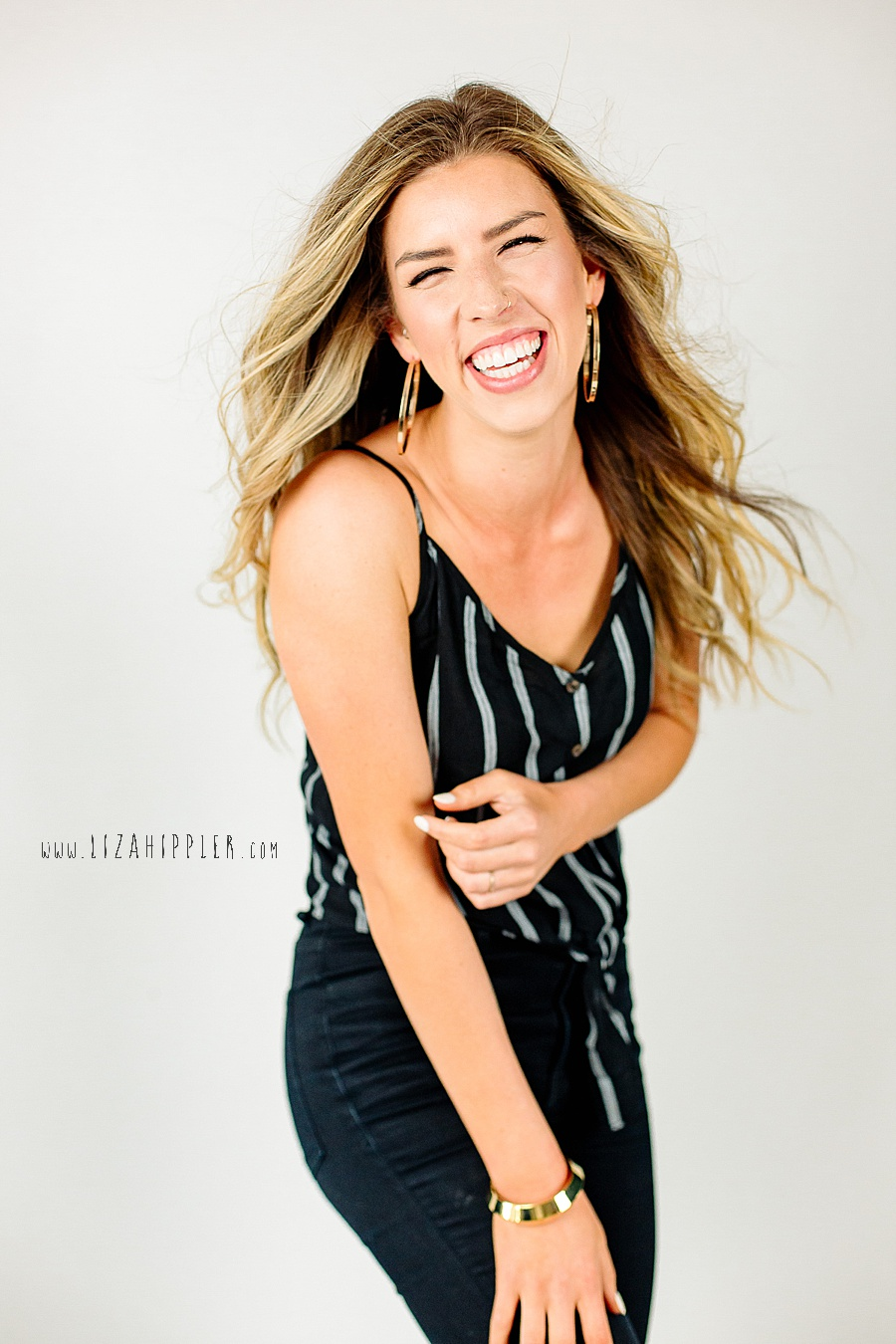 fun and personable work n play headshot blonde woman white background