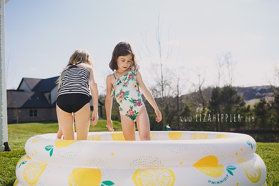 sisters in backyard pool