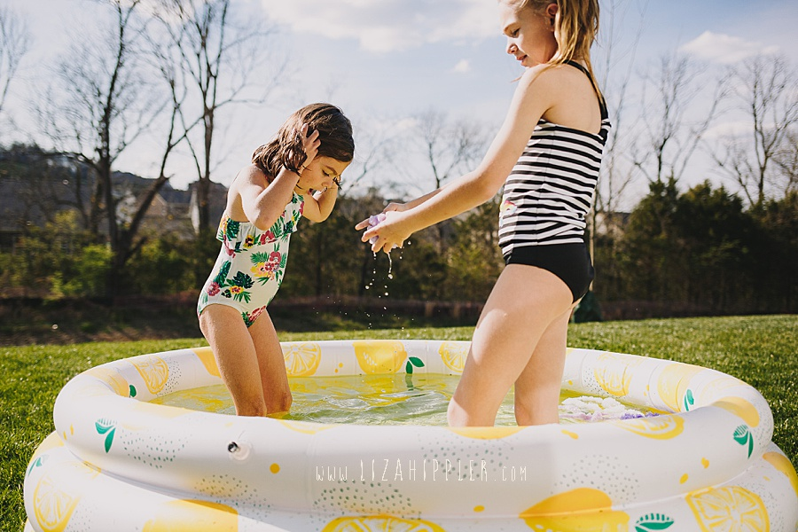 sisters playing in minidip lemon pool