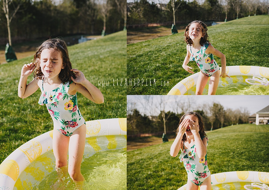little girl being silly in a blow up pool