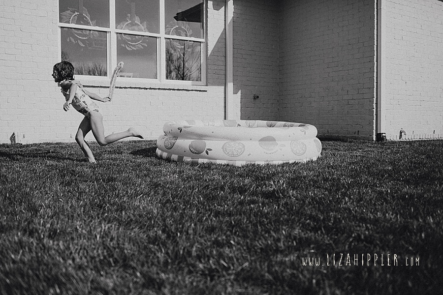 little girl running out of pool
