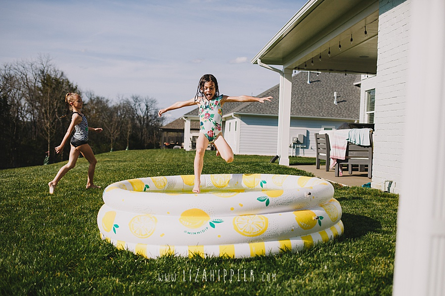 little girl does big jump into pool